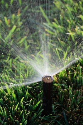 Lawn sprinkler service in Tulsa OK by Rowe Landscape Installation, LLC.
